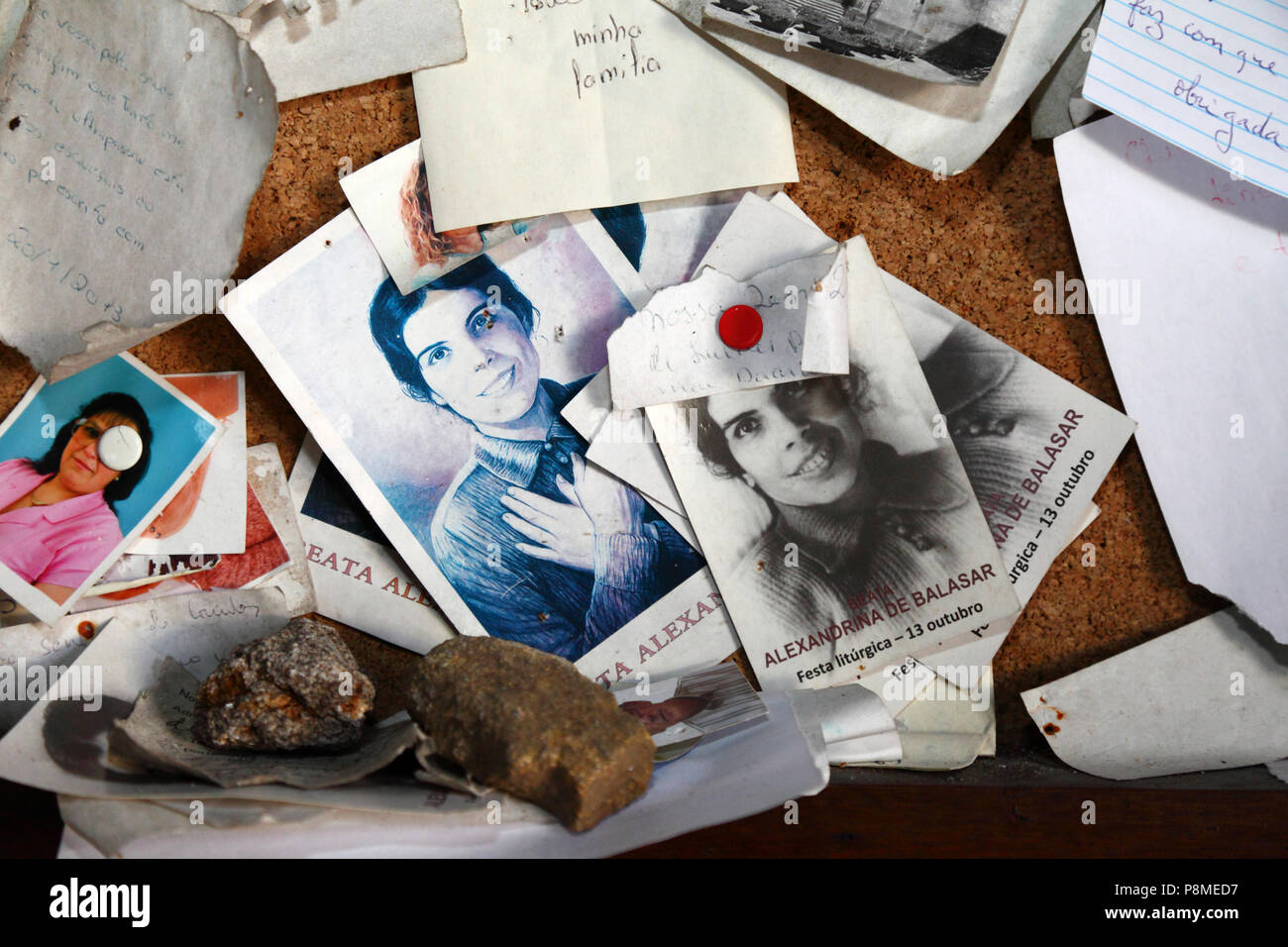 Letters of thanks and photos of devotees in Virgen of Lourdes grotto on Monte do Calvario, Vila Praia de Ancora, Minho Province, northern Portugal - Stock Image
