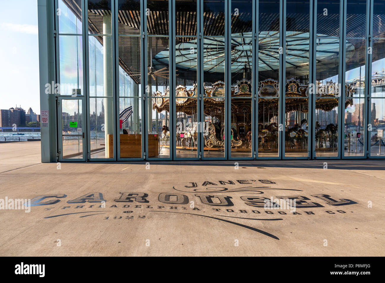 New York, City / USA - JUL 10 2018: Jane's Carousel at clear day afternoon in Brooklyn Bridge Park - Stock Image