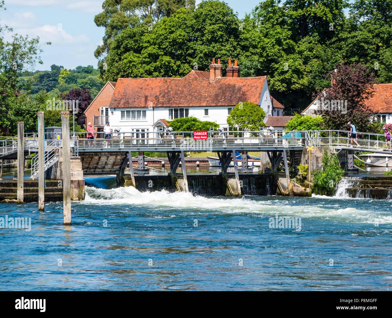 People Walking Across Weir, Hambleden Lock and Weir, River Thames, Berkshire, England, UK, GB. - Stock Image
