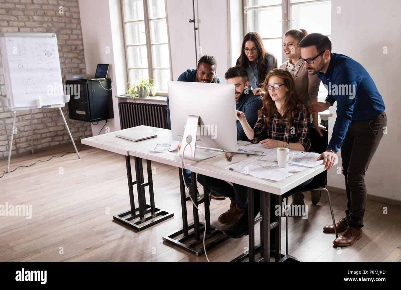Young architects working on project in office Stock Photo