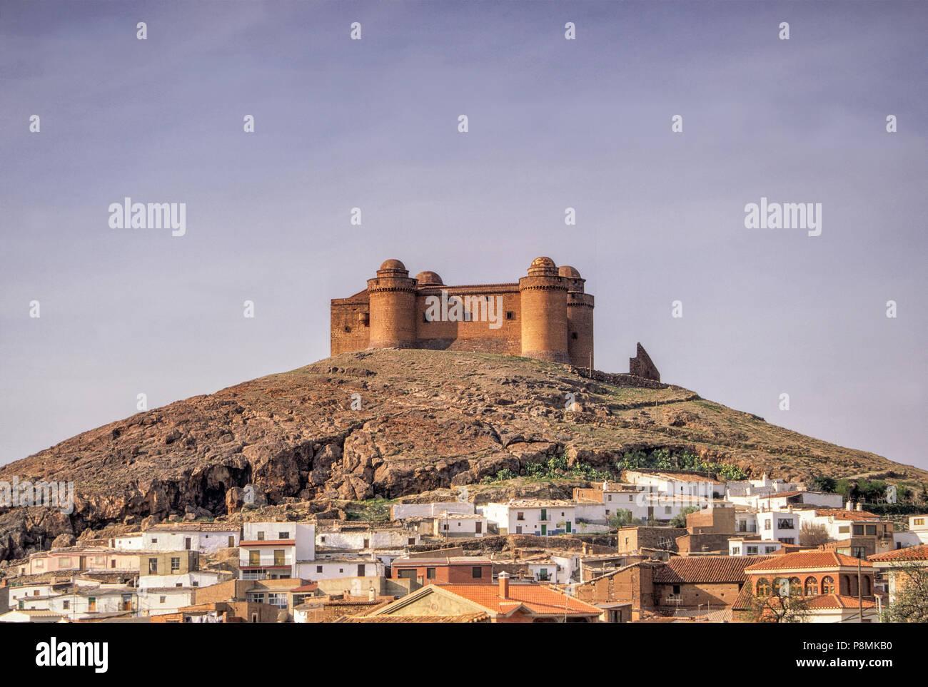 Castle above village of La Calahorra, Spain - Stock Image