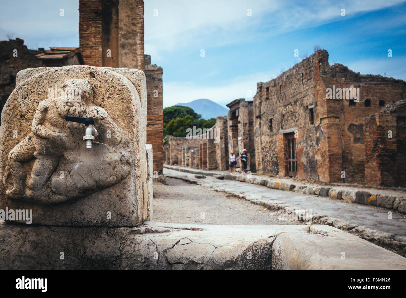 public fountain with hercules that kills the lion in the streets of Pompeii - Stock Image