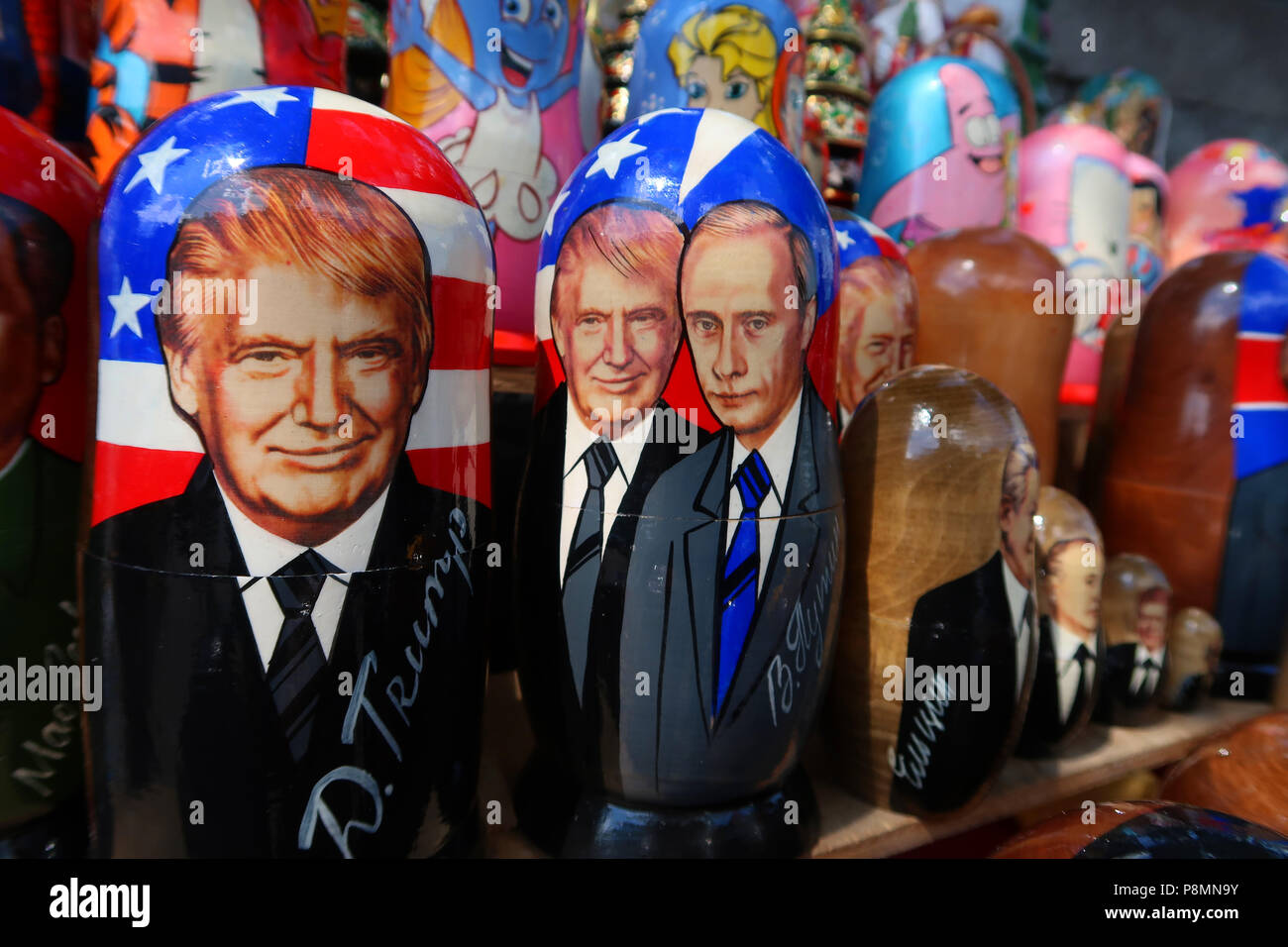 Traditional Matryoshka dolls depicting US President Donald Trump and Russian President Vladimir Putin for sale in a souvenir stall in the city of Kiev capital of Ukraine - Stock Image
