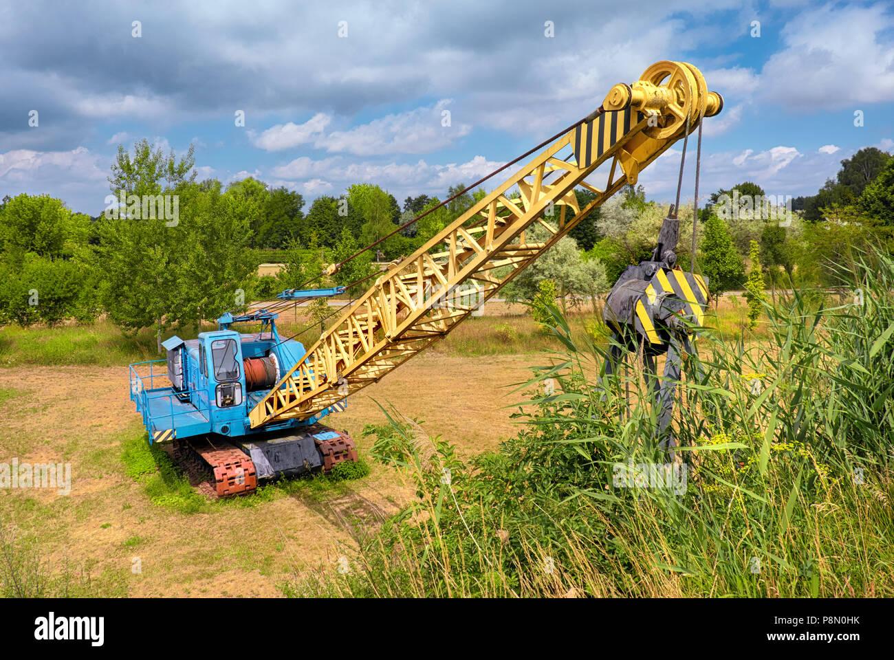Old German dragline excavator used for open pit coal mining in Brandenburg, Germany Stock Photo