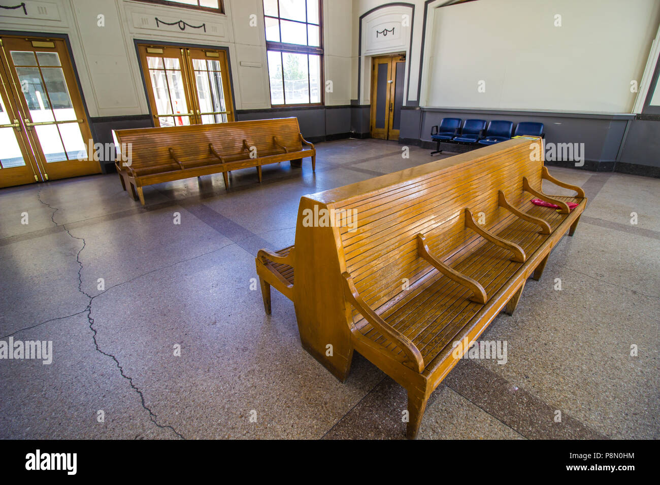 Old Wooden Benches In Railroad Depot Waiting Area - Stock Image