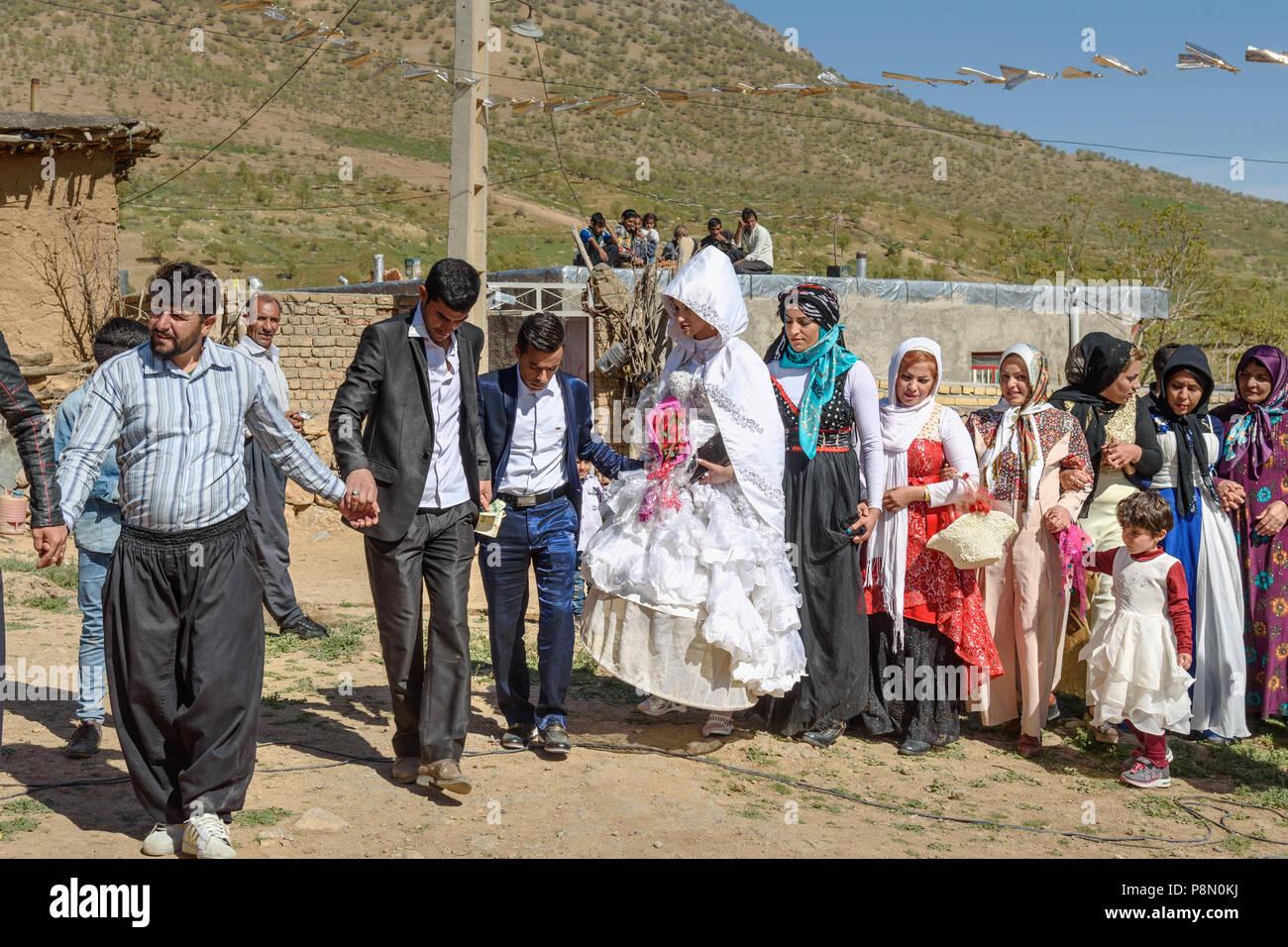 Lorestan Province, Iran - April 1, 2018: Lurish wedding ceremony in the village. - Stock Image