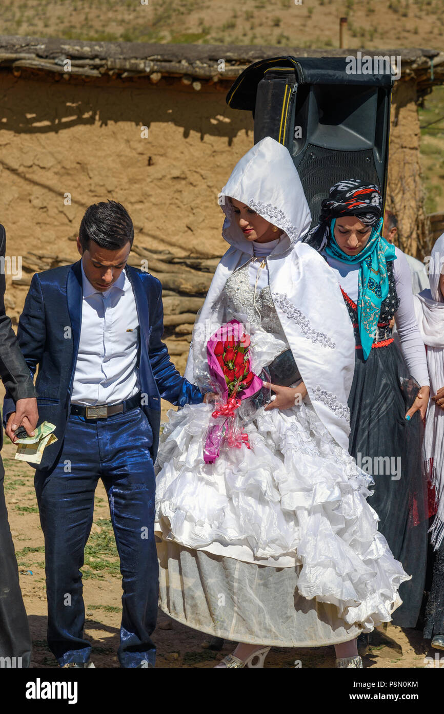Lorestan Province, Iran - April 1, 2018: Lurish wedding ceremony in the village. - Stock Image