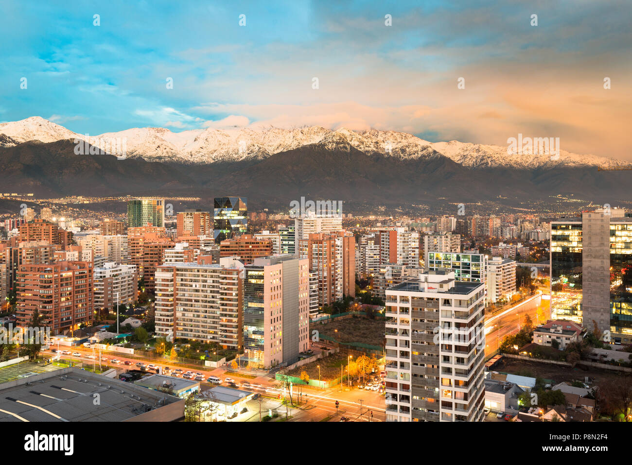 Apartment buidings in the wealhty district of Las Condes with The Andes mountain Range in the back, Santiago de Chile - Stock Image