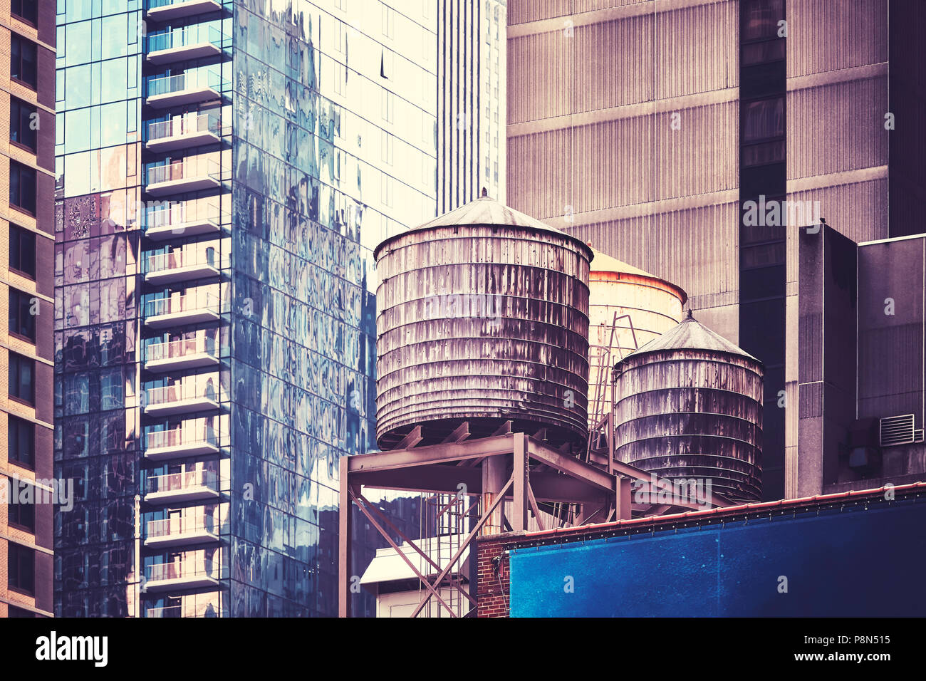 Water tanks on a roof, one of the New York City symbols, color toned picture, USA. - Stock Image