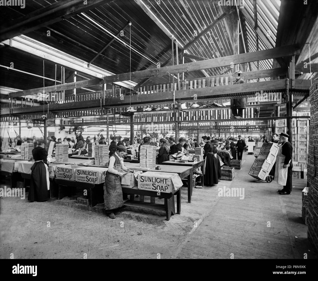 Lever Brothers Sunlight Soap Works, Port Sunlight, Wirral, Merseyside, 1897. Interior view showing workers packing soap boxes. - Stock Image