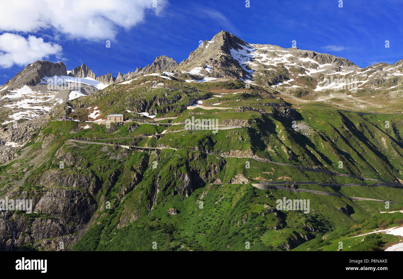 Serpentine road connecting alpine passes Furka and Grimsel in Swiss Alps, Europe Stock Photo