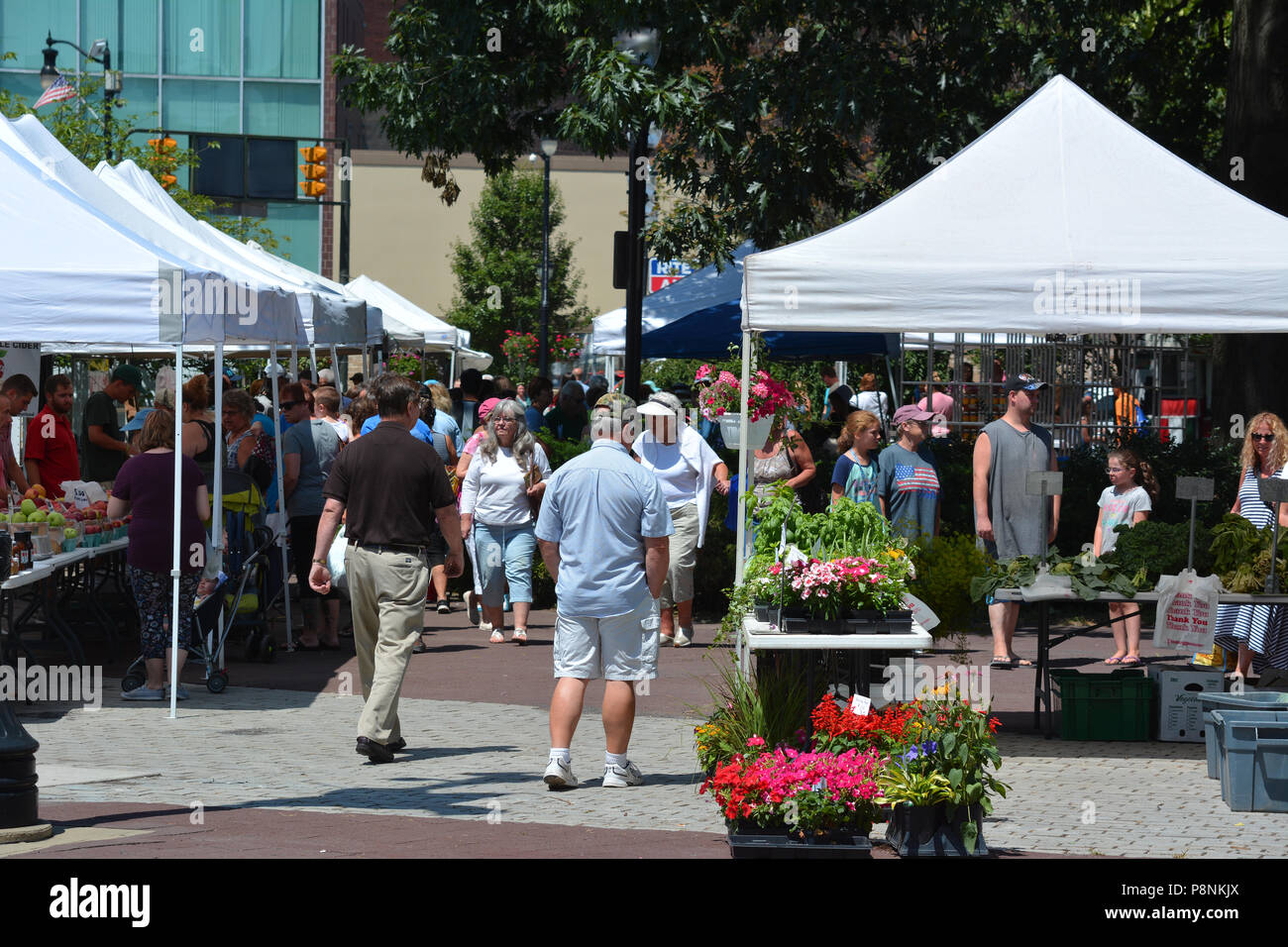 Random people scenes, Activities and people during Wilkes Barre PA's. popular thursday farmers market on the public square in central city July 2018 Stock Photo