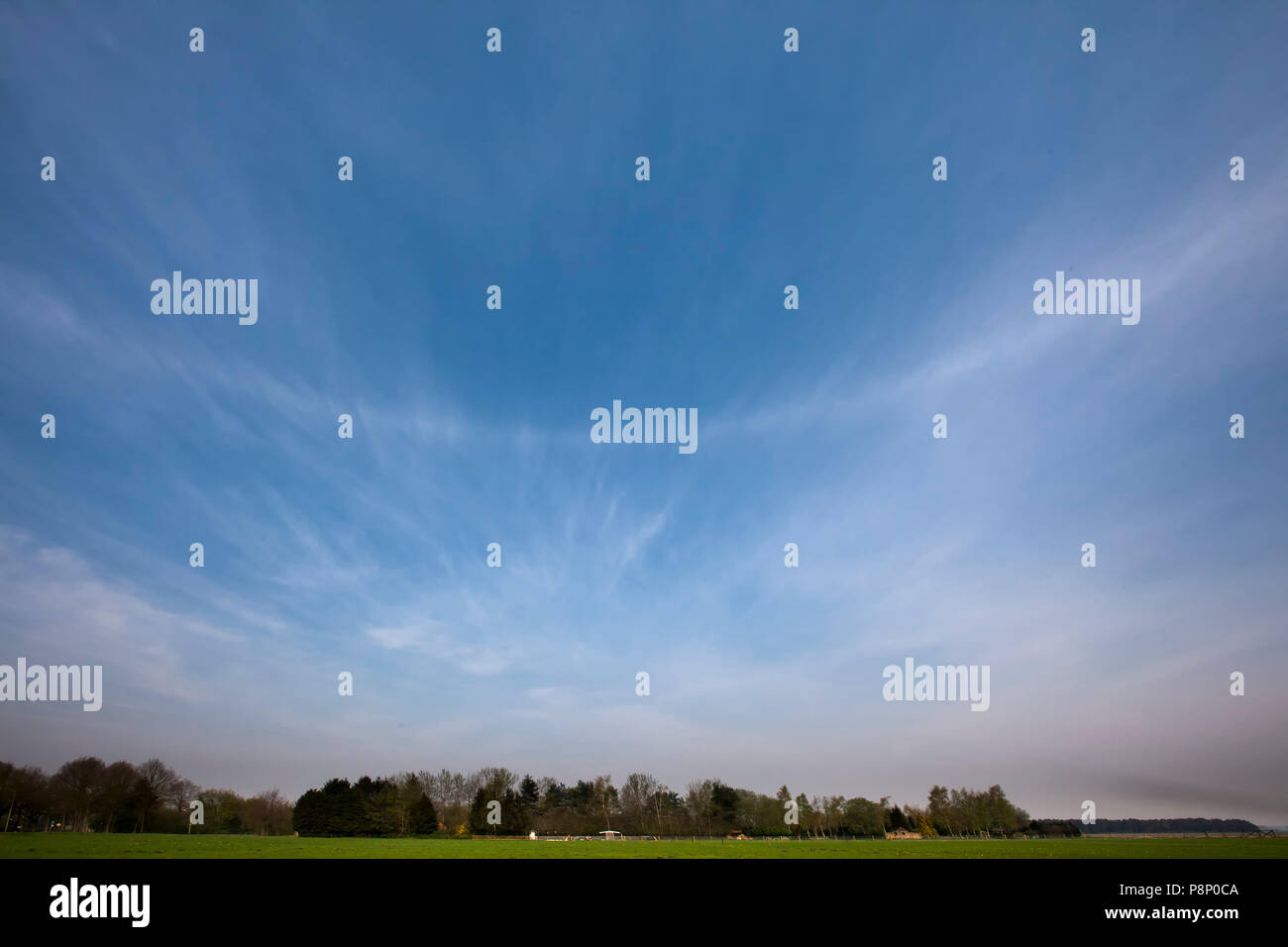 Parhelic circle in a blue sky (wide angle picture) - Stock Image