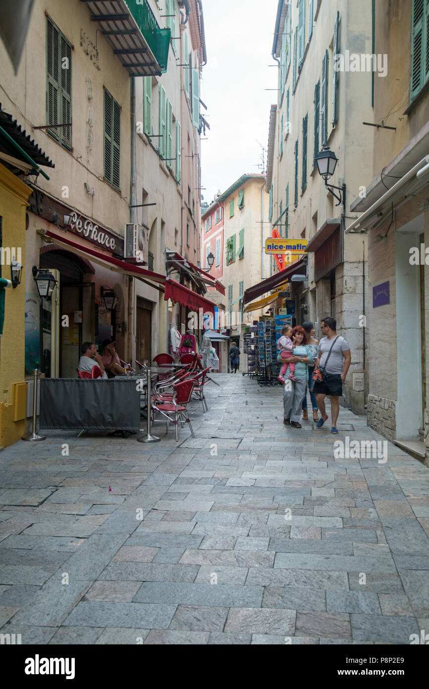 Villefranche Sur Mer, France, Jne 2018, views of streets in the town where tourists wander admiring the sights and seeking food. Stock Photo