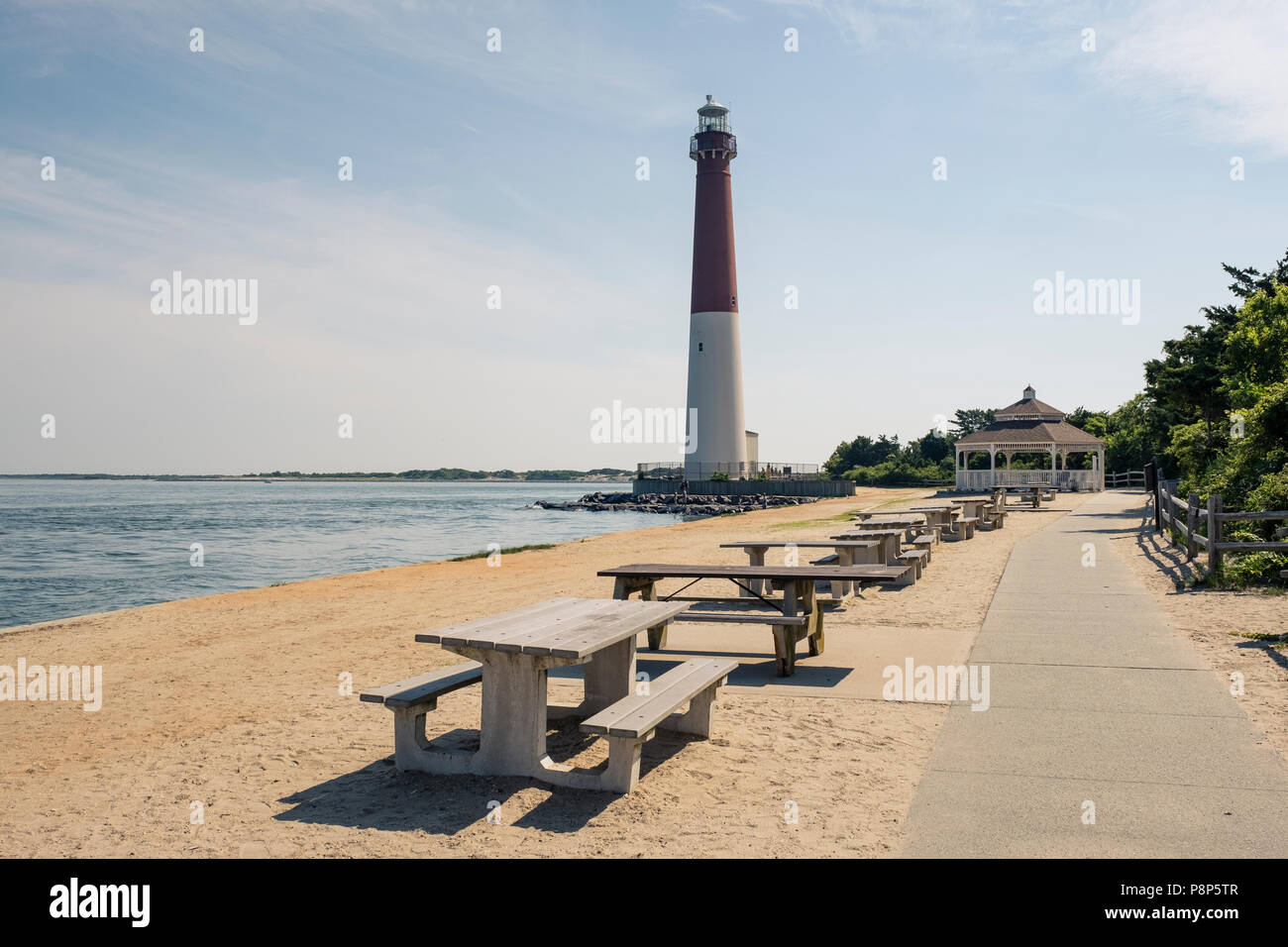 lighthouse in New Jersey provides warning light on island for ships navigating through ocean channels Stock Photo