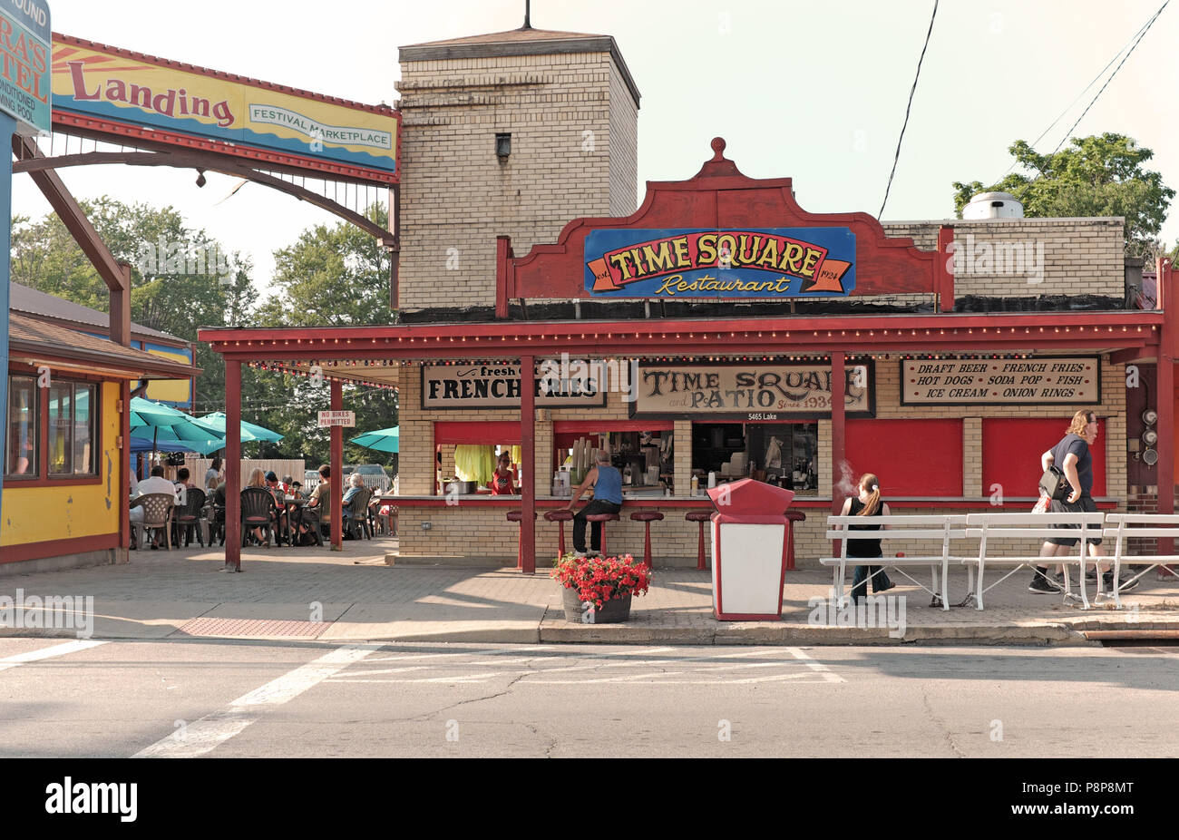 Old-school resort area of Geneva-on-the-Lake strip includes the Times Square eatery, a stalwart establishment in this popular summer destination. - Stock Image