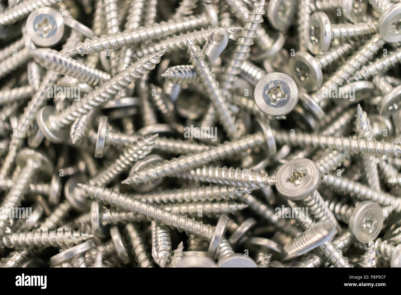 Collection of Screws in bucket - Stock Image