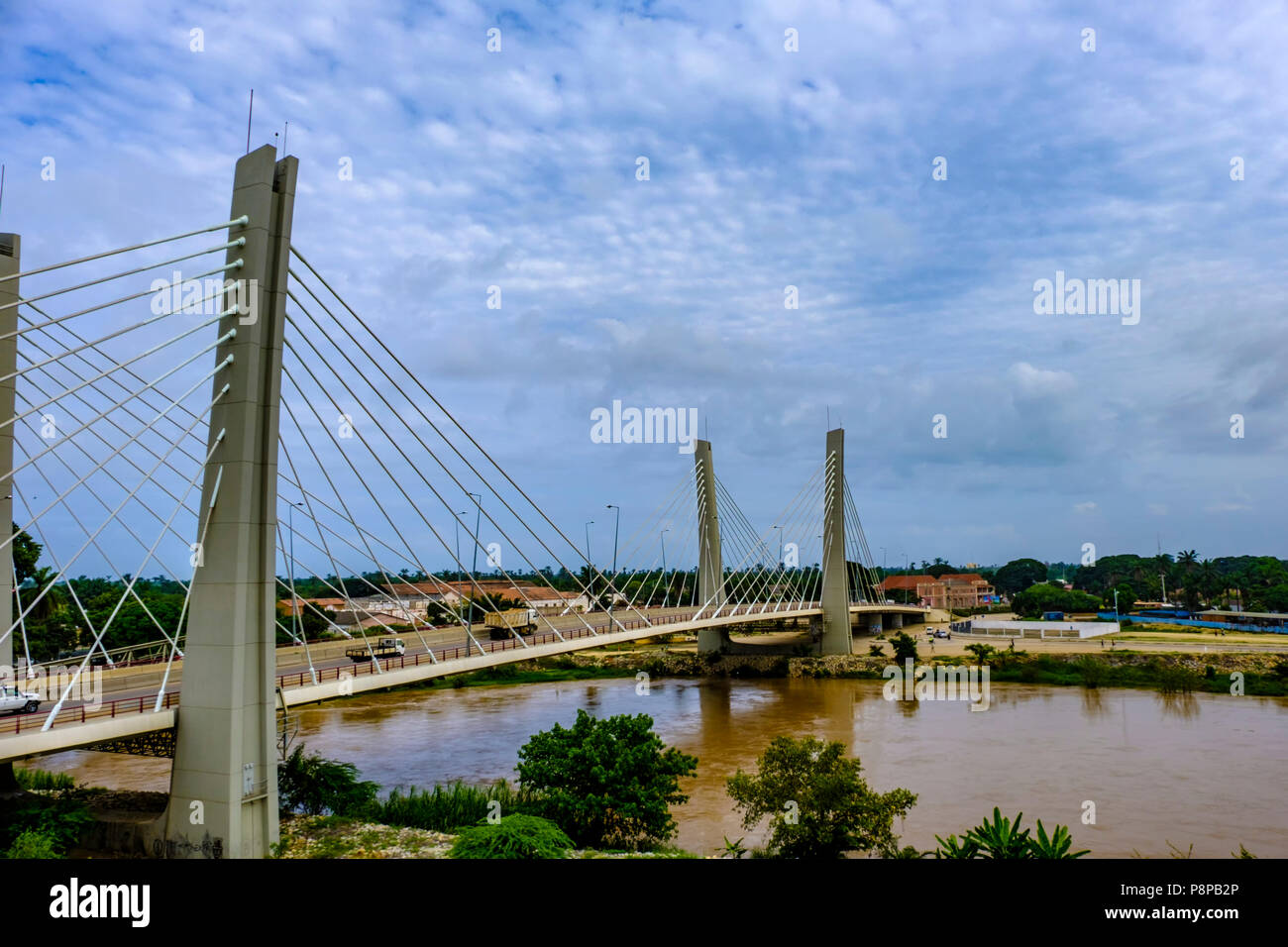 Modern suspension Bridge, 4 April, over Catumbela River links cities of Benguela and Lobito in Angola - Stock Image