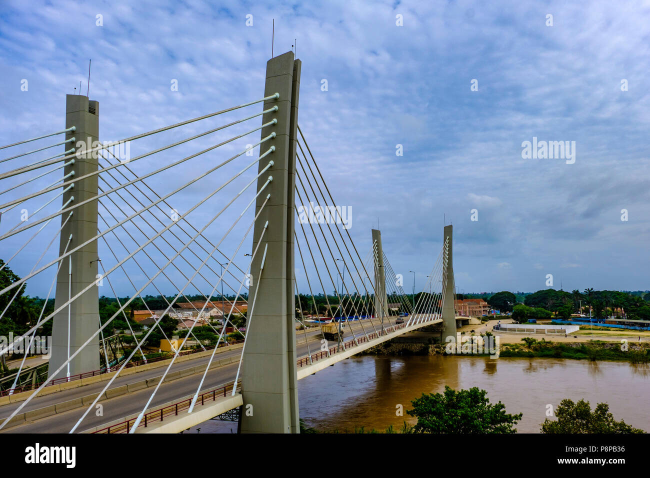 Traffic crosses modern suspension Bridge, 4 April, over Catumbela River linking cities of Benguela and Lobito in Angola - Stock Image