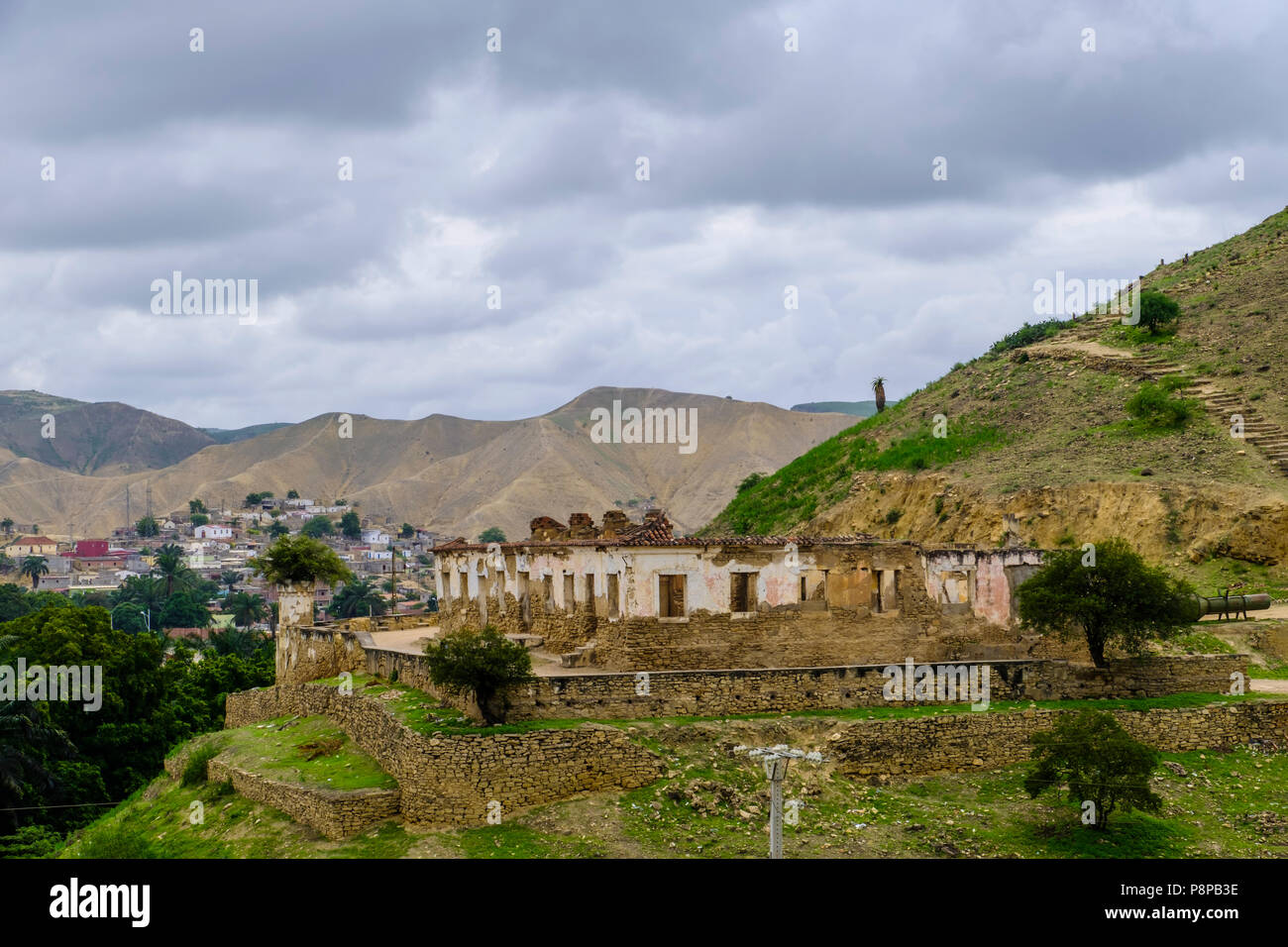 Remains of Portugese fort on hillside with city of Lobito Angola and hills in background - Stock Image