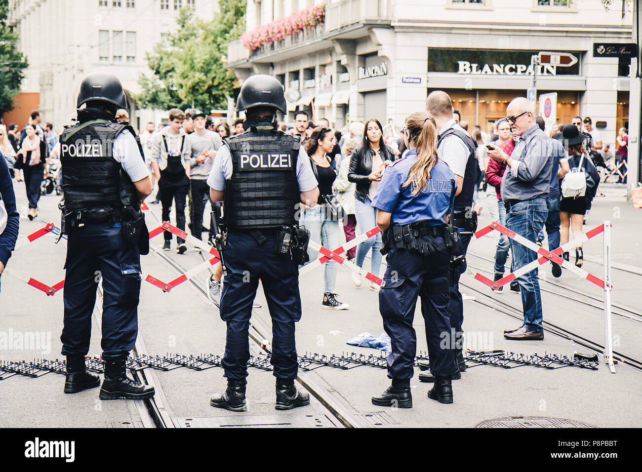Zurich, Switzerland - August 12, 2017: Crowds of people of all ages on one of the main streets of Zurich, Bahnhofstrasse, walking for the Street Parad - Stock Image