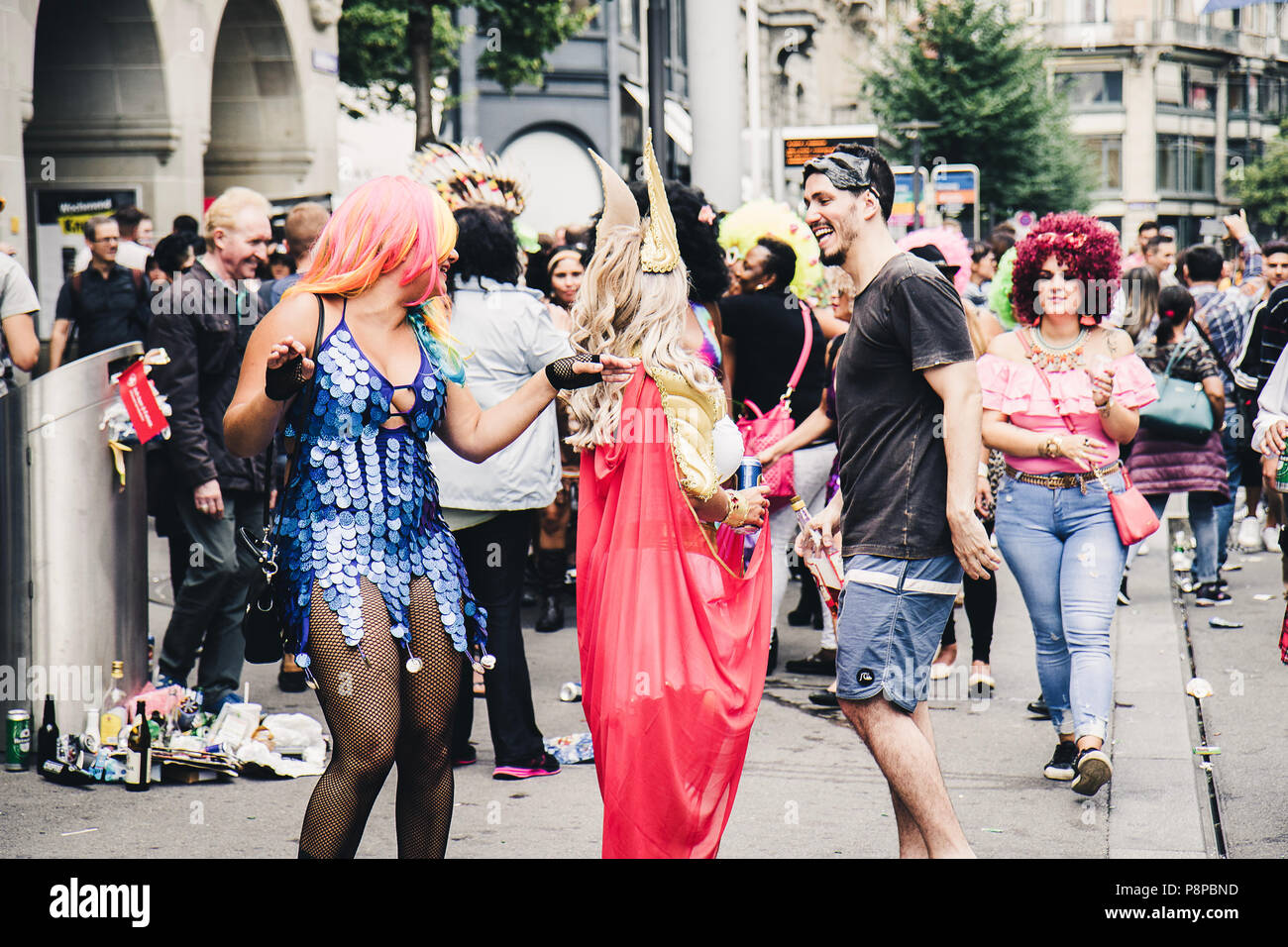 Zurich, Switzerland - August 12, 2017: People of all ages dressed up in fancy costumes for the Street Parade in Zürich and having fun. - Stock Image