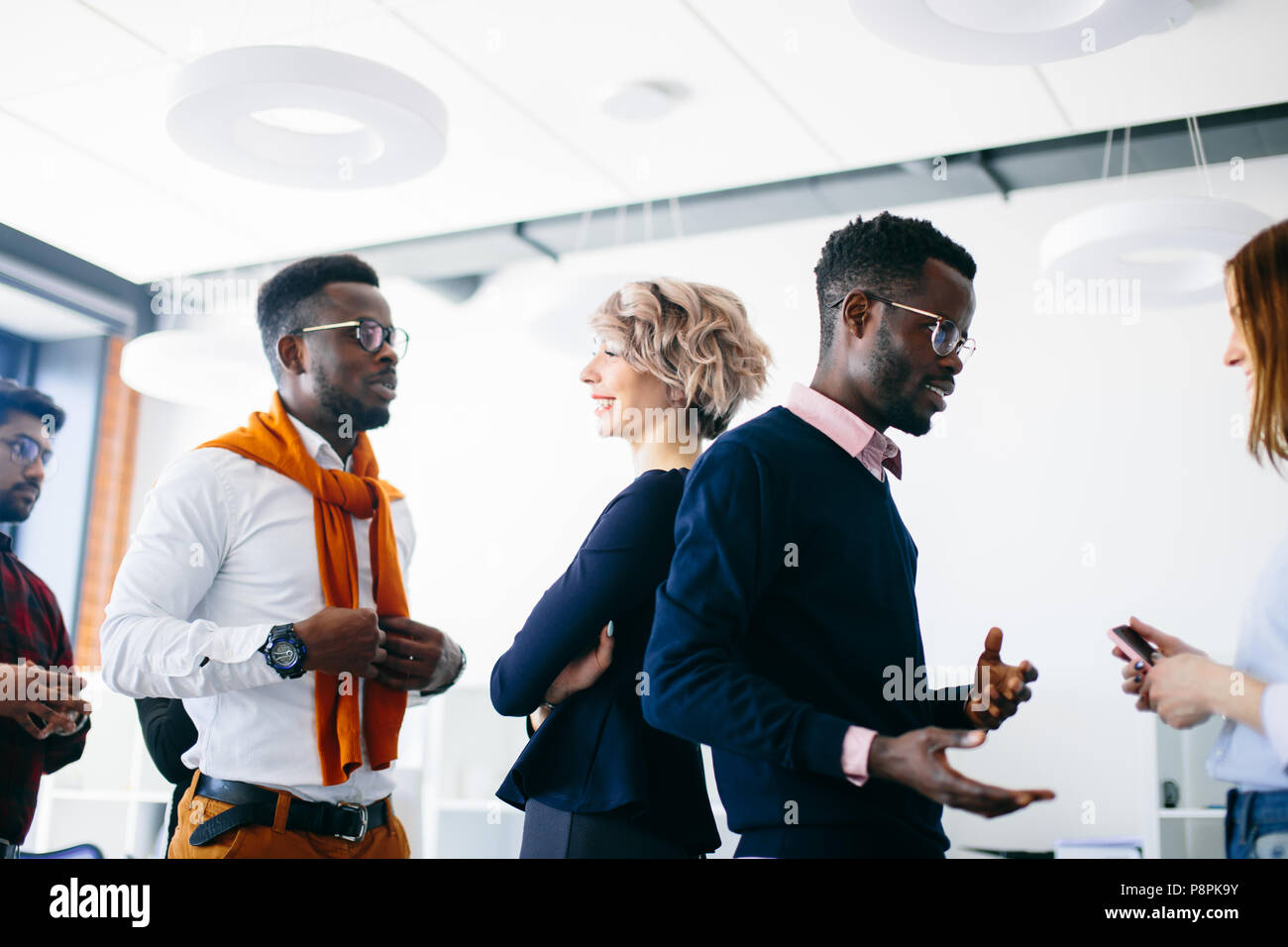 young energetic multiracial people are doing a barber in the studio - Stock Image