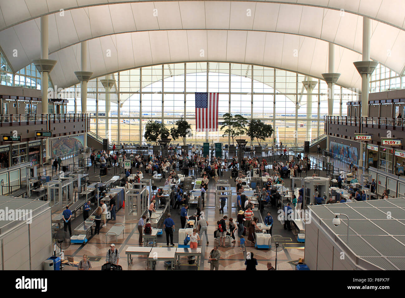 editorial concept related to airports,terminals,security at airport,holiday travel,busy travelling season - Stock Image