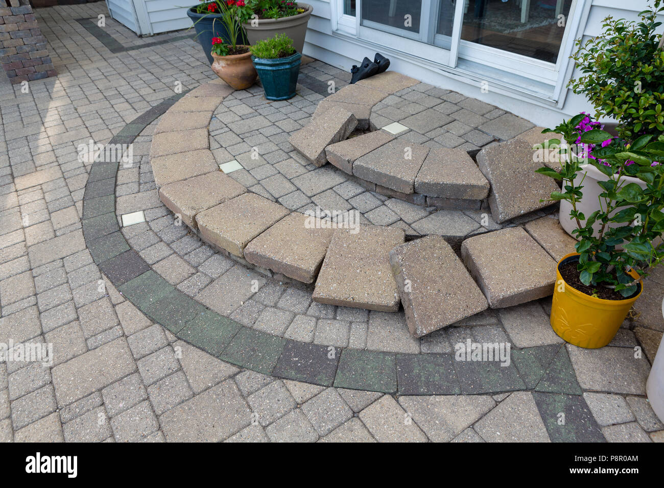 Replacing paving edging bricks on curved patio steps in front of the door to the house with them all laid neatly in position to commence work : curved patio - thejasonspencertrust.org