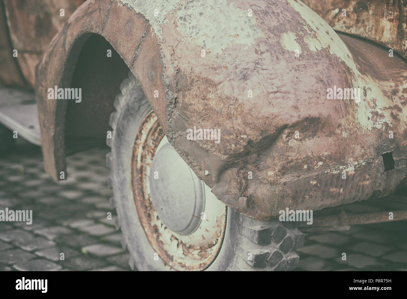 Rusty crumpled front wing with the wheel and tire vintage car - Stock Image