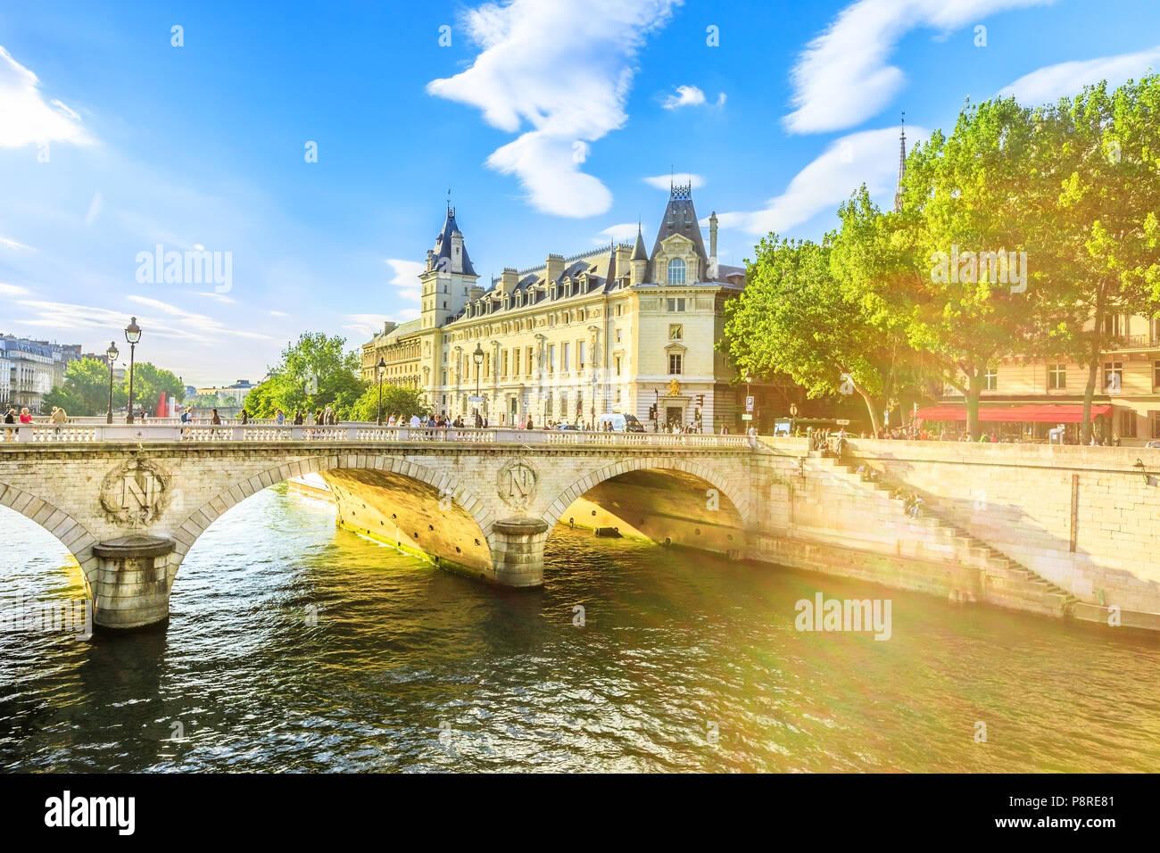 Pont au Change at sunset, bridge over river Seine and Conciergerie, a historic Parisian building within Palais de Justice complex, Ile de la Cite.Castle in former royal palace and prison Paris, France - Stock Image