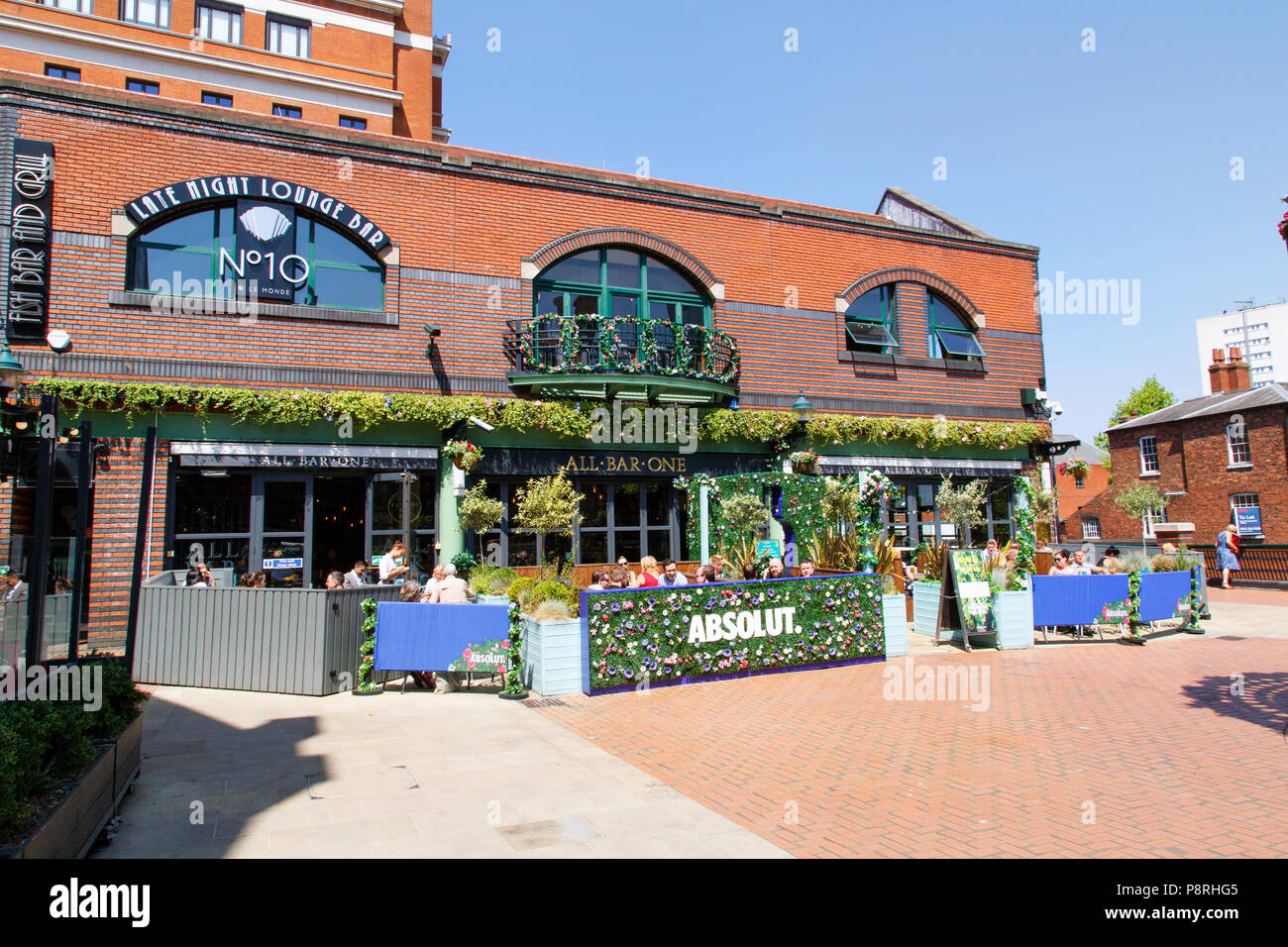 Birmingham, UK: June 29, 2018: Tourists relax and enjoy the refreshments at a restaurant located on the restored Birmingham Canal System. - Stock Image