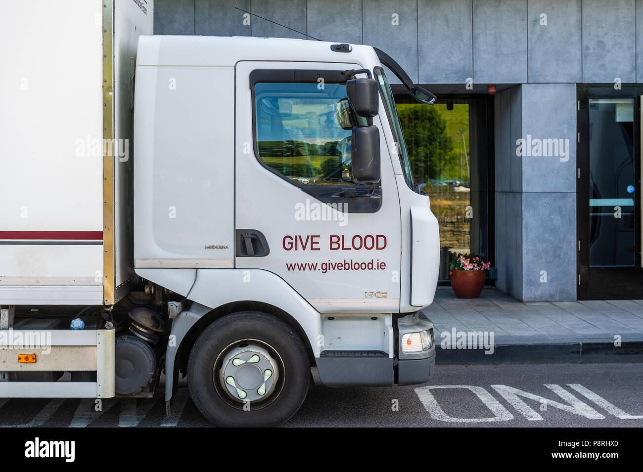 Irish Give Blood truck parked outside the Maritime Hotel, Bantry, West Cork, Ireland. - Stock Image