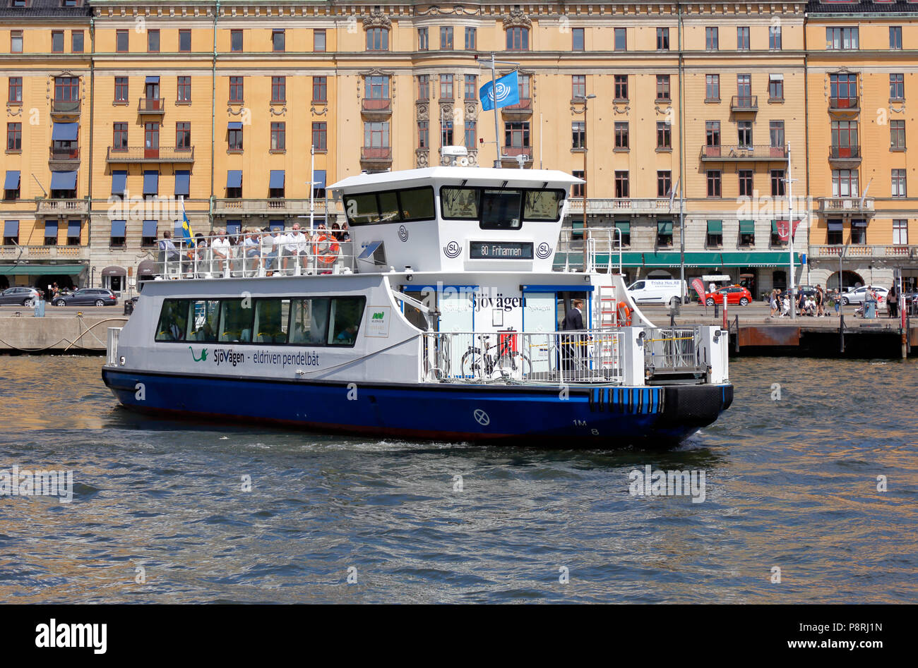 Stockholm, Sweden - July 12, 2018: The electric powered shuttle public transportation ferry Sjovagen in service on line 80 for SL, has departured from Stock Photo