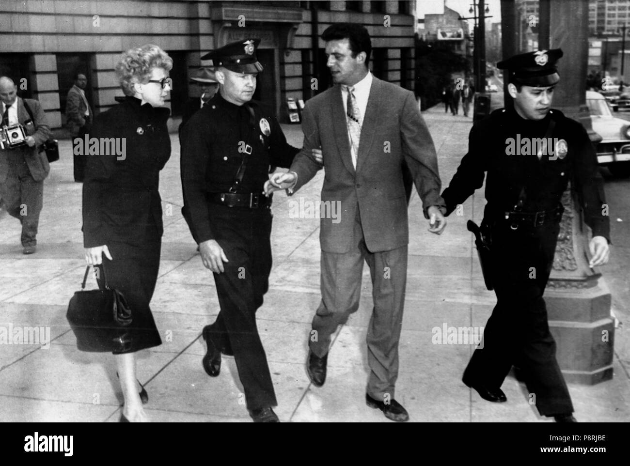 shelley winters, anthony franciosa, accompanied by police after a quarrel with photographers, beverly hills, los angeles, california, April 20, 1957 - Stock Image
