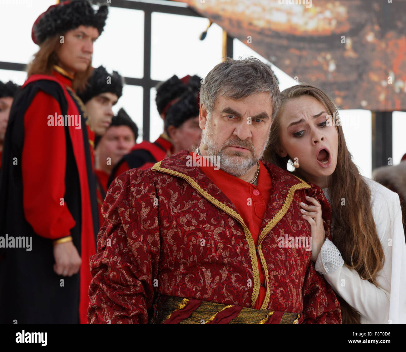 St. Petersburg, Russia - July 12, 2018: Soloist of Mariinsky theater Alexander Nikitin as Grigory Gryaznoy (center) and Olga Cheremnykh as Marfa in th - Stock Image