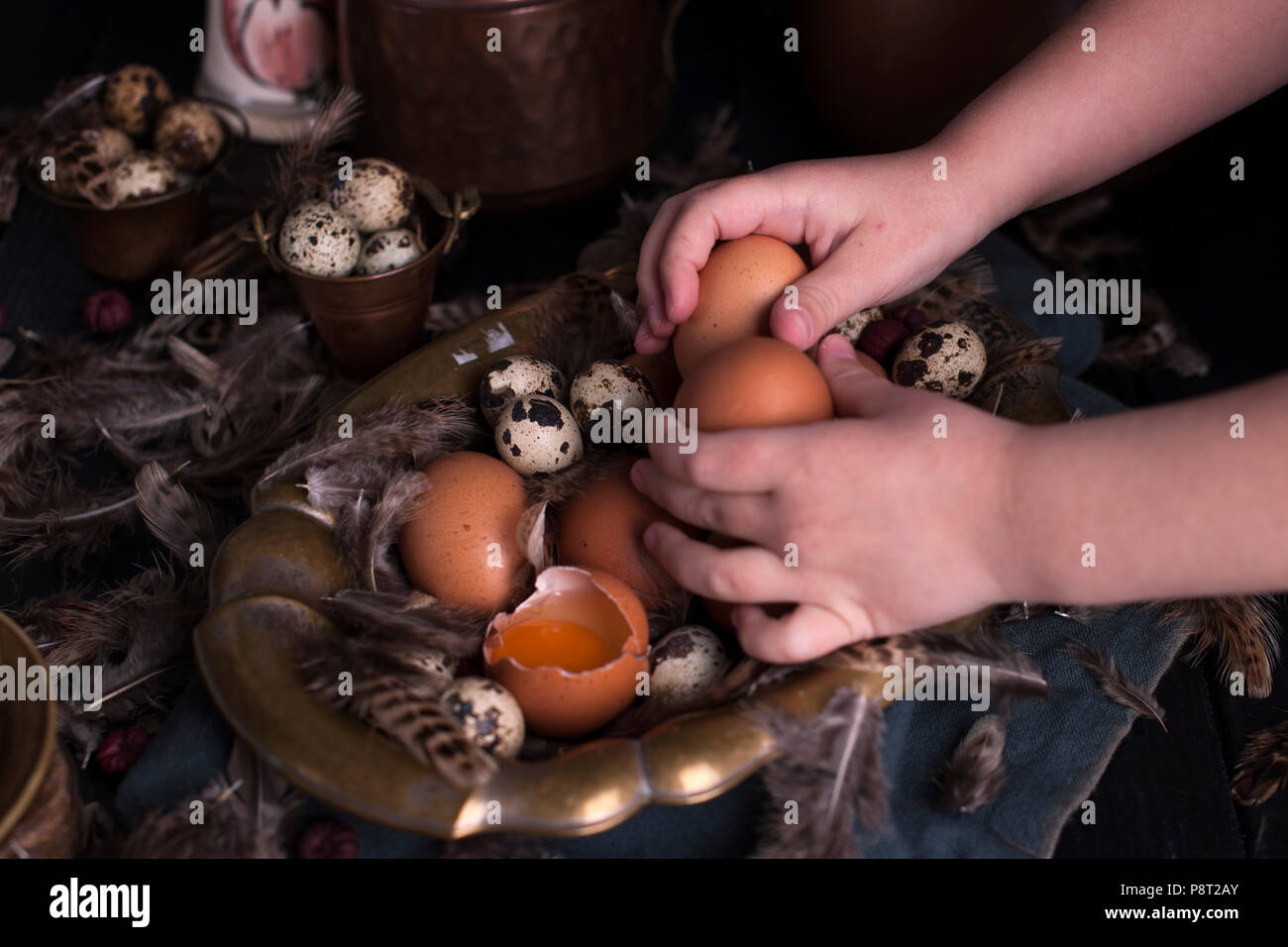Childrens Hands In The Frame Easter Eggs Large And Small Feathers