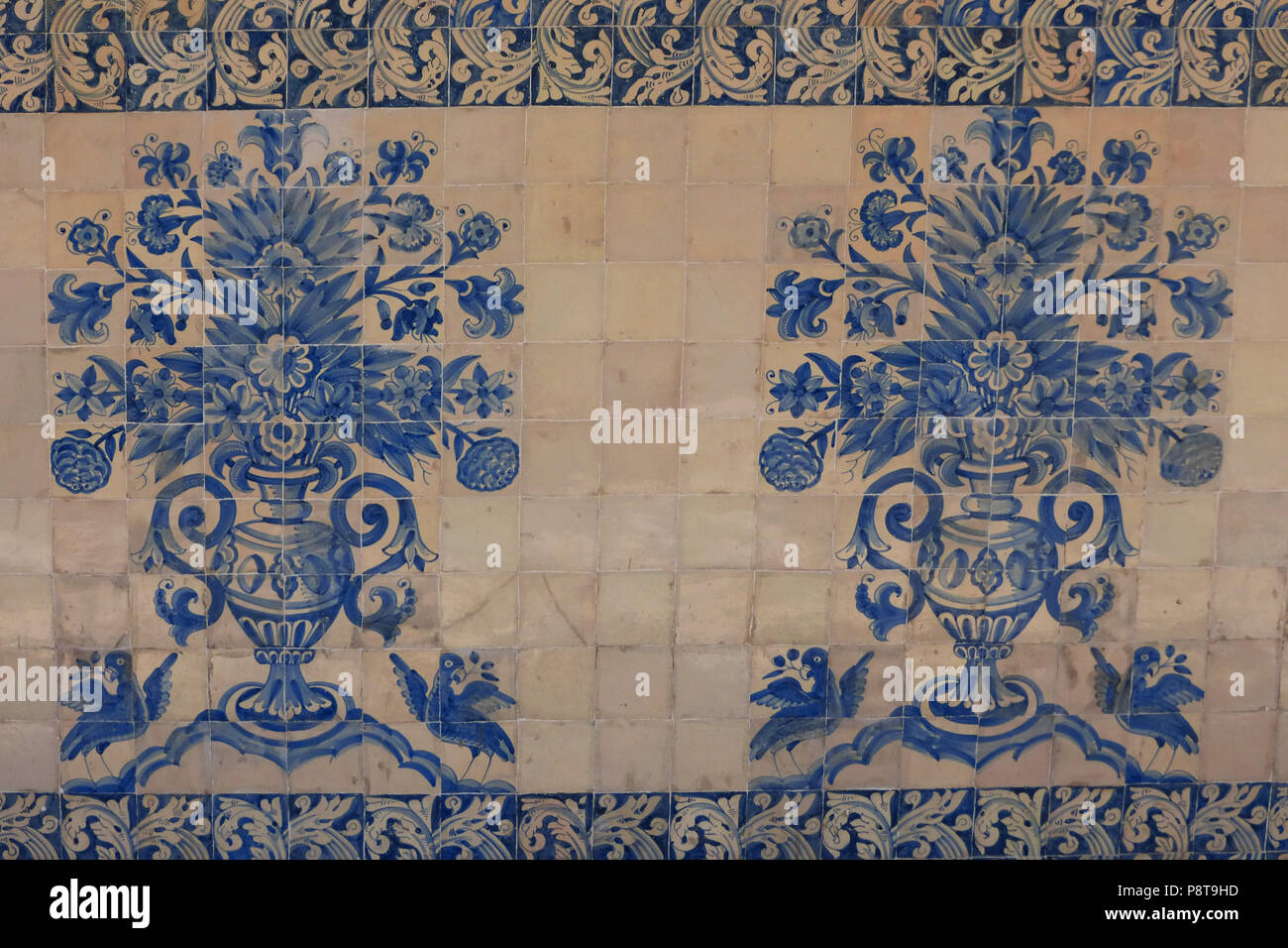 Traditional azulejos blue tiles in a passage way at Coimbra university. Portugal Stock Photo