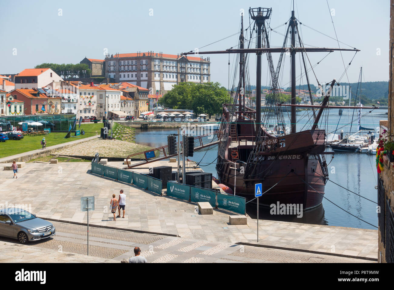 View of Vila do Conde and the river Ave with a reproduction of a 16th century carrack (Nau Quinhentista) and Convent of Santa Clara in the distance - Stock Image