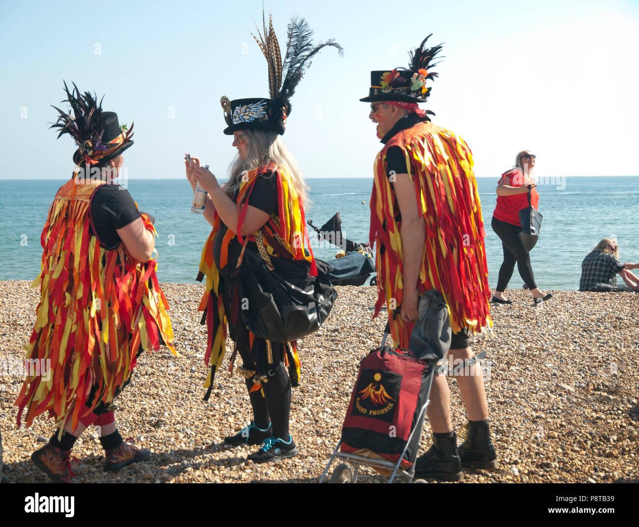 Morris dancers on the beach at Brighton - Stock Image