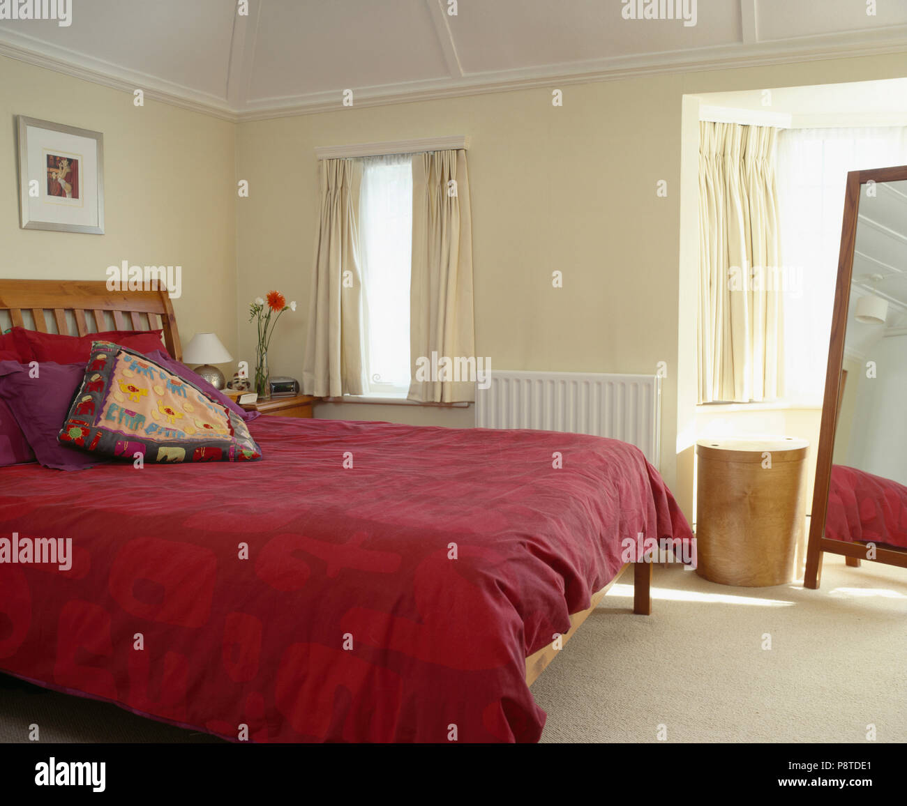 Red Duvet On Bed In Cream Bedroom With Cream Curtains Stock Photo Alamy