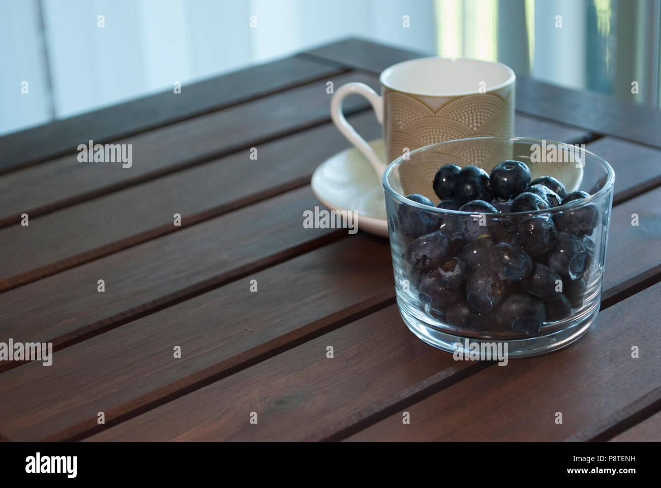 Morning cup of coffee on the balcony. Healthy breakfast. Stock Photo