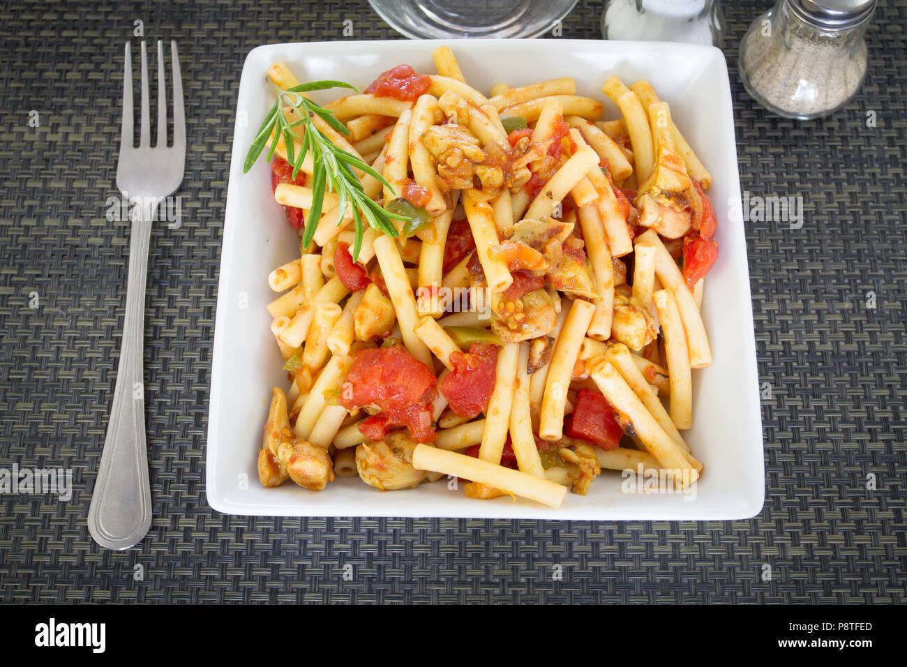 Sautéed pork and Provencal pasta - Stock Image