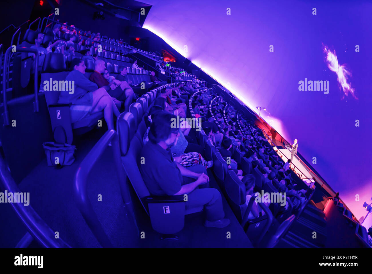 Garden City, New York, USA. June 21, 2018. NASA space shuttle astronaut MIKE MASSIMINO, a Long Island native, is on stage giving free lecture to audience in the JetBlue Sky Theater Planetarium at the Cradle of Aviation Museum. Stock Photo