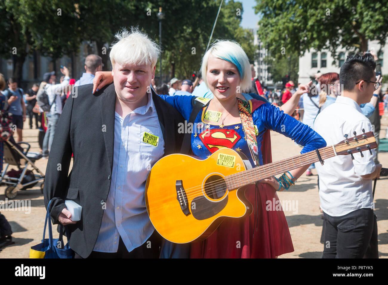 London, UK. 13th July, 2018. Boris Johnson and 'EU Supergirl' Madeleina Kay in Parliament Square Credit: Zefrog/Alamy Live News - Stock Image