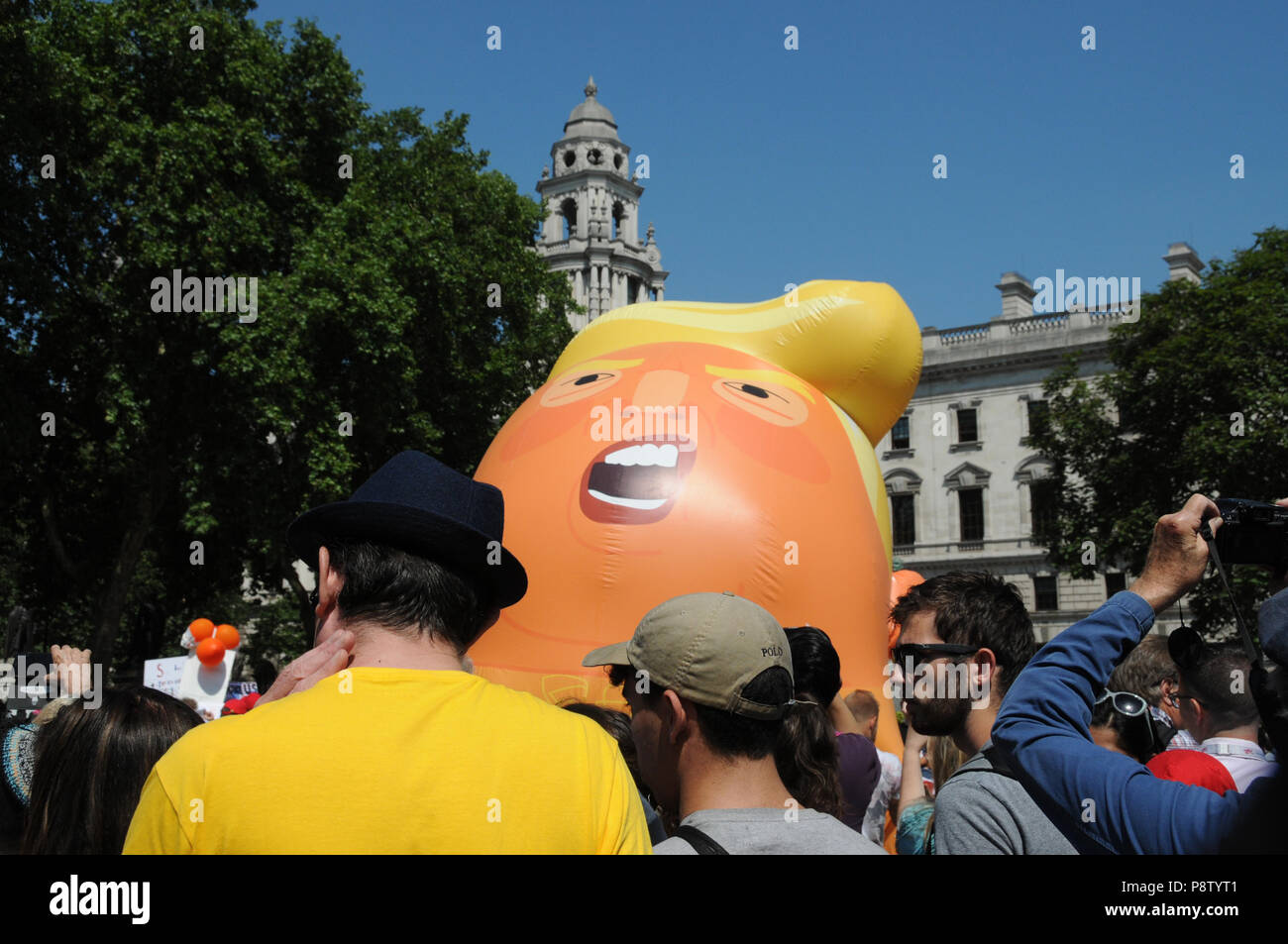 The Donald Trump inflatable balloon in London's Parliament Square. - Stock Image