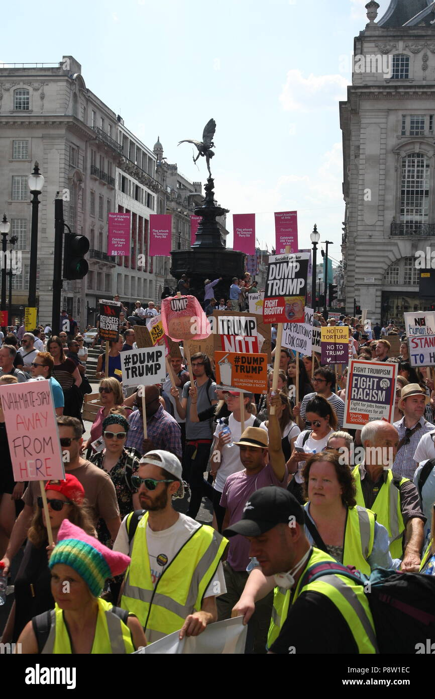 London, UK, 13th July 2018. Protesters march against US President Donald Trump, bringing the streets of London to a stand still. Roland Ravenhill/ Alamy Live News. Stock Photo