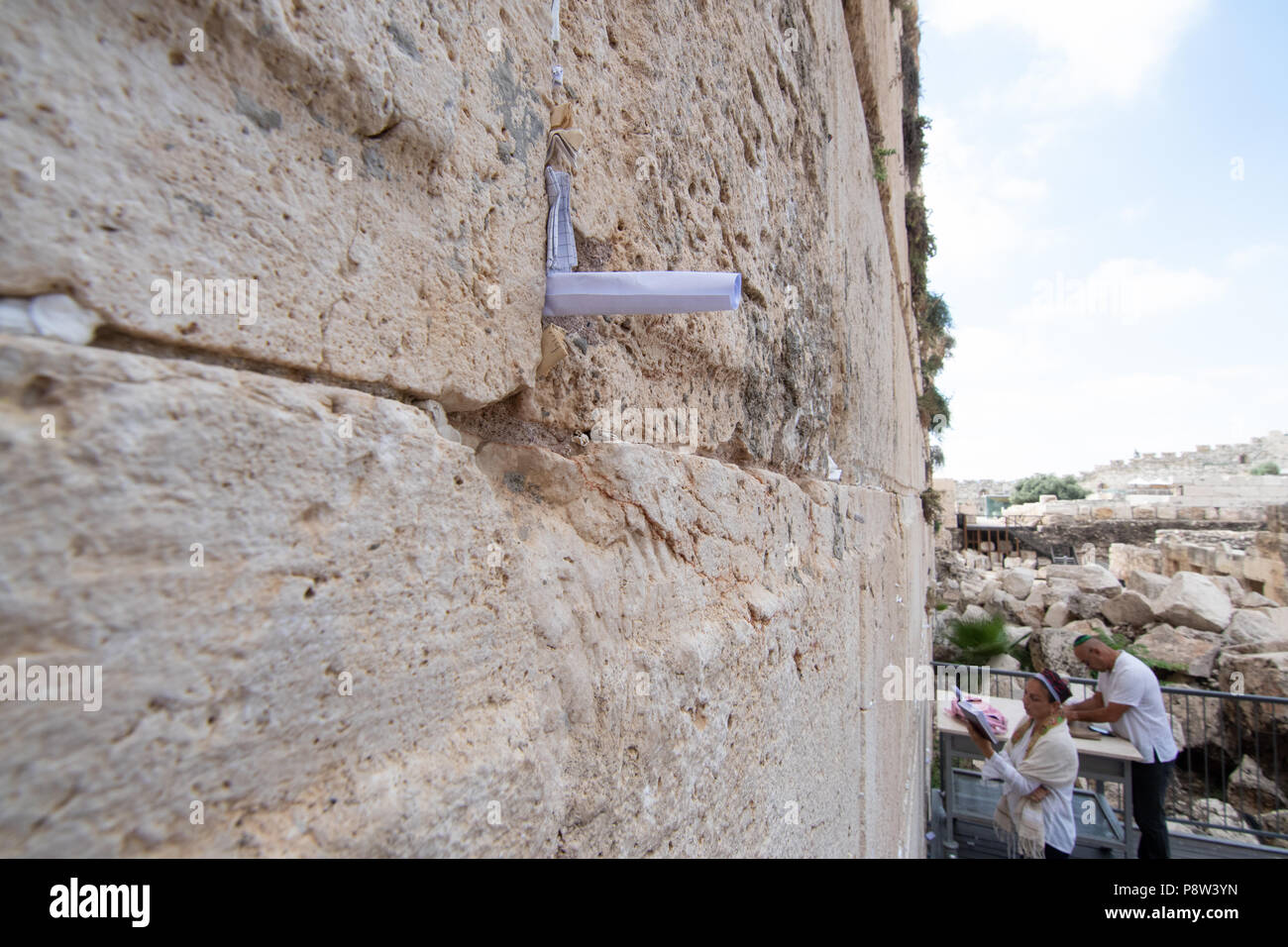 Jerusalem, Israel. 13th July, 2018. Papers with wishes and prayers left by the people in between the Western Wall stones. © Valentin Sama-Rojo/Alamy Live News. - Stock Image