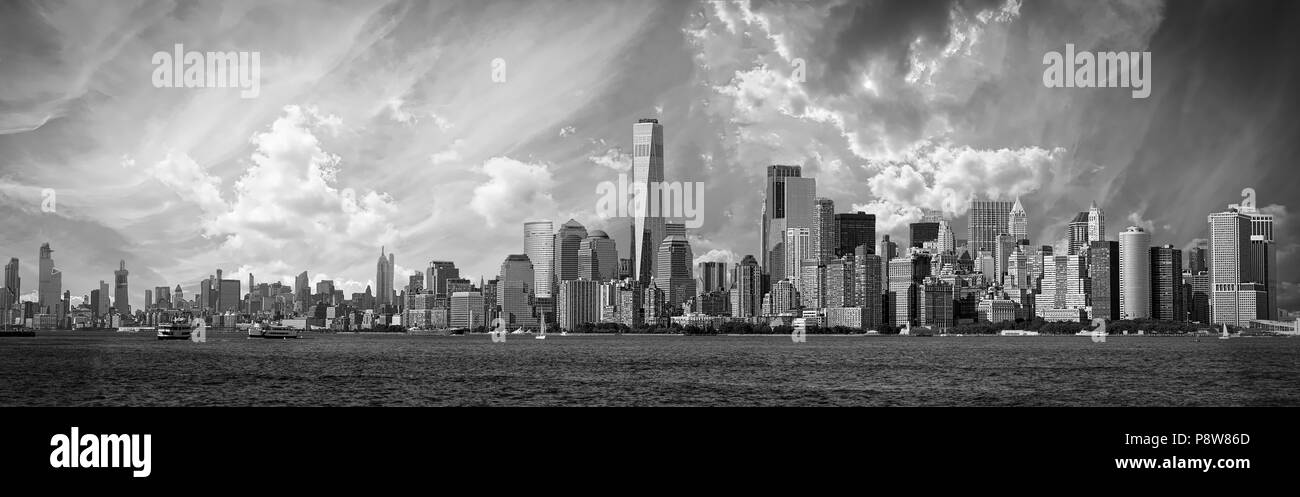 The skyline of New York City on a hot summer day from the Upper Bay from a ferry. - Stock Image