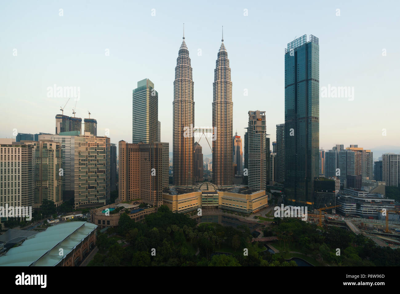 Kuala lumpur cityscape. Panoramic view of Kuala Lumpur city skyline during sunrise viewing skyscrapers building and Petronas twin tower in Malaysia. - Stock Image
